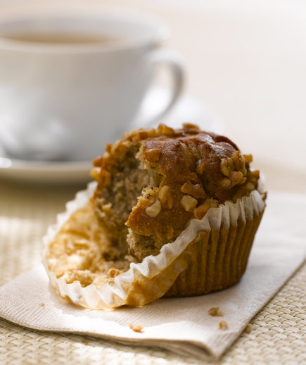 Muffin with a cup of coffee.