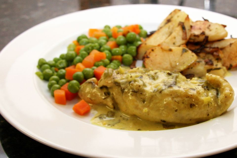 Chicken breast, peas, carrots, and potatoes with creamy curry sauce