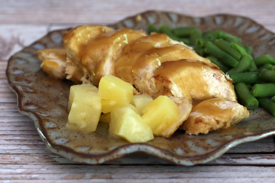 A plate of pineapple baked chicken and green beans